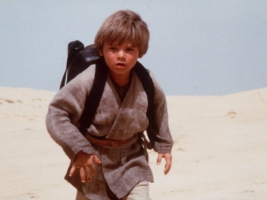 "Jake Lloyd is pictured as Anakin Skywalker in this photograph from ""Star Wars: Episode 1 - The Phantom Menace.""  Keith Hamshere/AP -  -05-14-1999, Ticket p. 7 Jake Lloyd, who portrays Anakin Skywalker in ""Star Wars: Episode 1 _ The Phantom Menace,"" is pictured in this still photograph from the movie."