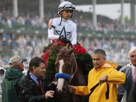 Mike Smith takes Justify to the winner's circle at the Kentucky Derby.