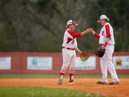 Mary Pat Thomas fist bumps teammate Jackson Boone during their game against Rickards last week.