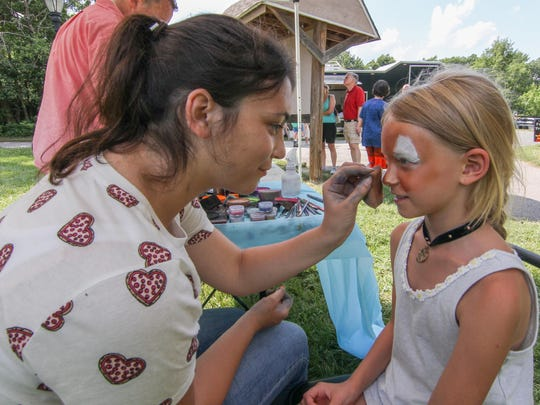 Talia Deutsch (8) of Media, PA. has her face painted during Bellevue State Park 40th celebration Sunday, July 02, 2017, at Bellevue State Park in Wilmington.
