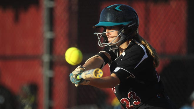 Florida High's Bri Pichard slaps a hit during the Seminoles' 12-2 win over North Bay Haven on Tuesday to capture a District 1-4A title.