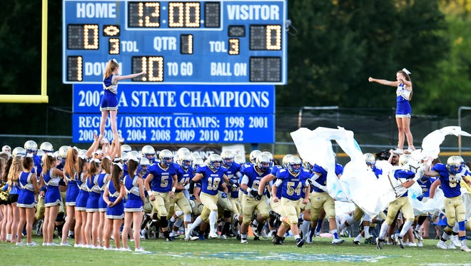 The Brentwood Bruins charge the field to take on the Independence Eagles at Brentwood High School Friday Aug. 21, 2015, in Brentwood, Tenn.