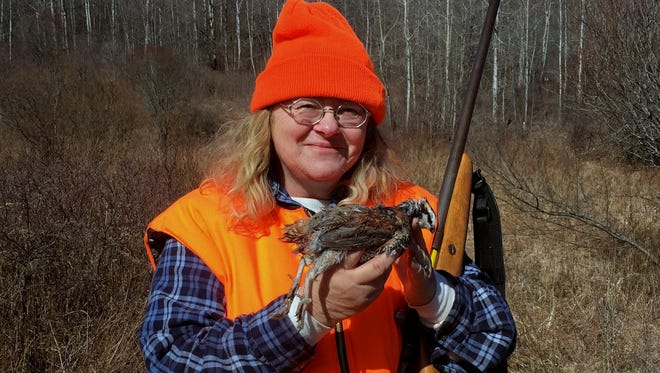 Carol shows off a quail she bagged Saturday at North Country Outfitters.