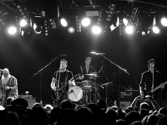 (L-R) Musicians Dave Catching, Jesse Hughes, Josh Homme and Matt McJunkins of Eagles of Death Metal perform at the Teragram Ballroom on October 19, 2015 in Los Angeles, California.