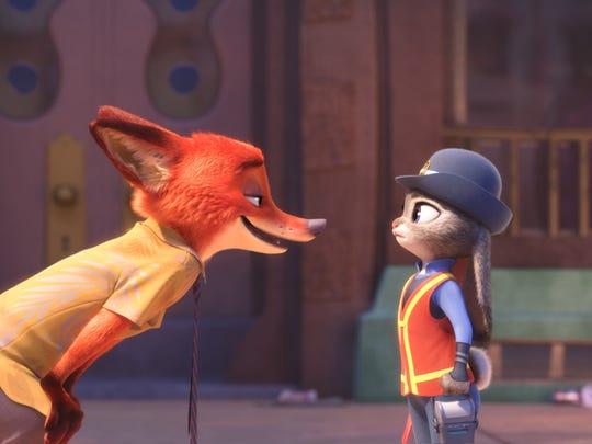 Zootopia's Nick Wilde (voiced by Jason Bateman) and bunny officer Judy Hopps (Ginnifer Goodwin) speak to audiences.