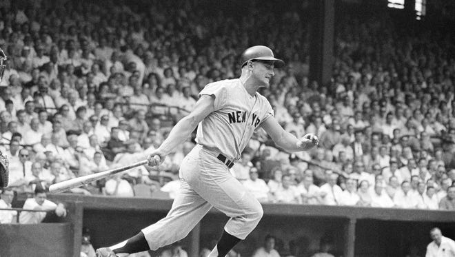 Roger Maris in action for the New York Yankees. He hit 61 homers in '61 to make history and was honored in Rochester the following year with the coveted Hickok Belt.