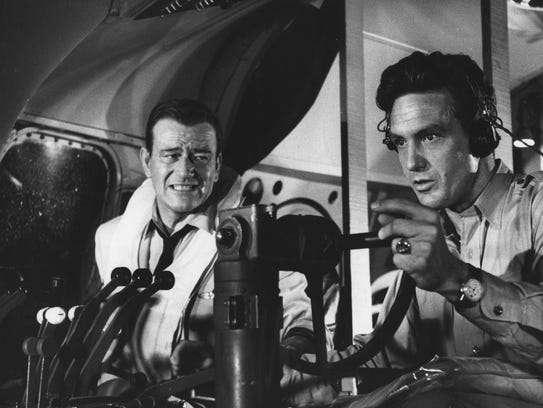 John Wayne (left) and Robert Stack in the airborne