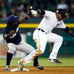 May 20, 2015; Detroit, MI, USA; Detroit Tigers left fielder Yoenis Cespedes (52) is tagged out by Milwaukee Brewers second baseman Elian Herrera (3) trying to steal second in the sixth inning at Comerica Park. Mandatory Credit: Rick Osentoski-USA TODAY Sports
