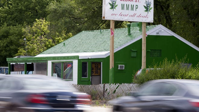 Lansing officials are still working on an ordinance that would create regulations for medical marijuana establishments like this one located on Cedar Street. A sixth draft of the proposed ordinance will be reviewed Friday at City Hall.