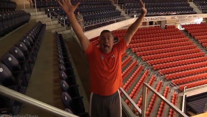 Auburn coach Bruce Pearl made a trick shot from the upper level of Auburn Arena.