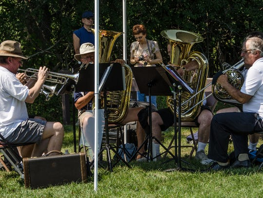 The Novi Brass Band performs during the vintage baseball