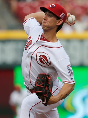 Cincinnati Reds starting pitcher Michael Lorenzen (50) delivers to the plate in the first inning during the MLB game between the Cincinnati Reds and Chicago Cubs, Monday, July 20, 2015, at Great American Ball Park in Cincinnati. Lorenzen used ace pitcher Johnny Cueto's glove during the game.