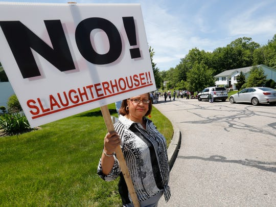 Althea Mundy of New Hempstead gets ready to join a recent protest of the industrial chicken slaughterhouse planned just across the border in New Square.