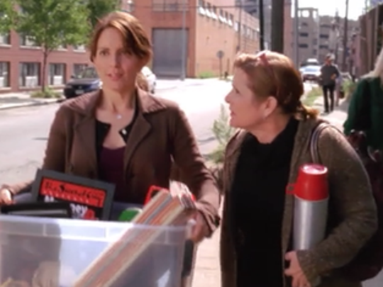 "Tina Fey and Carrie Fisher in a scene from ""Rosemary's Baby,"" an episode of ""30 Rock."""