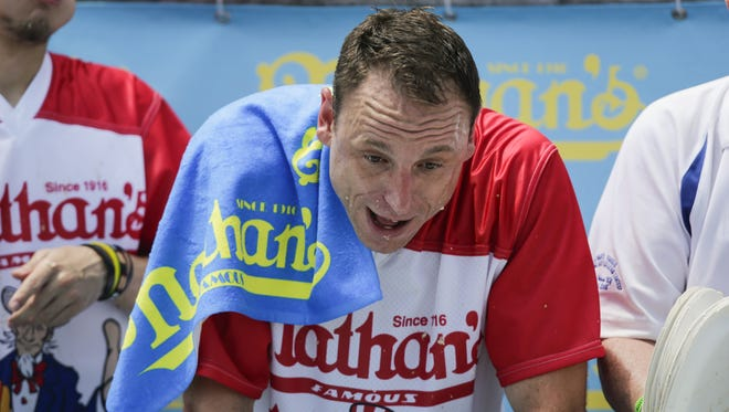 Joey Chestnut reacts after competing during the annual Nathan's Hot Dog Eating Contest on July 4, 2018 in the Coney Island neighborhood of the Brooklyn borough of New York City. Joey Chestnut won the contest, eating a Coney Island record 74 hot dogs in 10 minutes.  (Photo by Eduardo Munoz Alvarez/Getty Images)