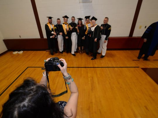 A photo being taken of Saturday's graduates in the Shapiro Field House on Norwich's Northfield campus.