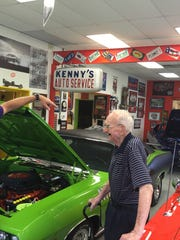 Ken Mosier, owner of The Finer Details automotive restoration shop in Danville, talks with Harry Donovan about plans to restore Donovan's 1967 Mustang.