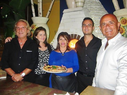 From left, the extended Girasole family includes Alessandro Comella, Carla Comella, Maria Covino, Carmine Covino and Gino Iovino.