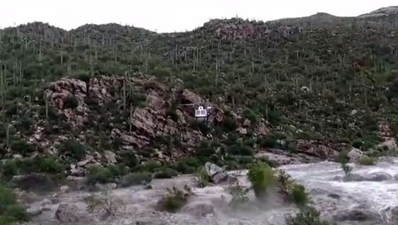 Seventeen hikers were stranded in a flash flood at Tanque Verde Falls Sunday.