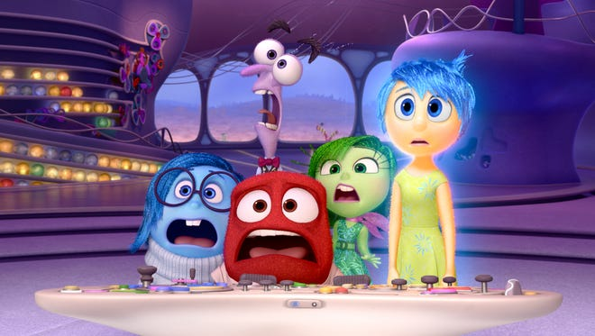 Sadness (voiced by Phyllis Smith), Fear (Bill Hader), Anger (Lewis Black), Disgust (Mindy Kaling) and Joy (Amy Poehler) deal with emotional chaos in 'Inside Out.'