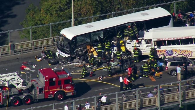 Rescue workers evacuate a charter bus after it and a Ride the Ducks tour vehicle collided Sept. 24, 2015, on a bridge north of downtown Seattle.