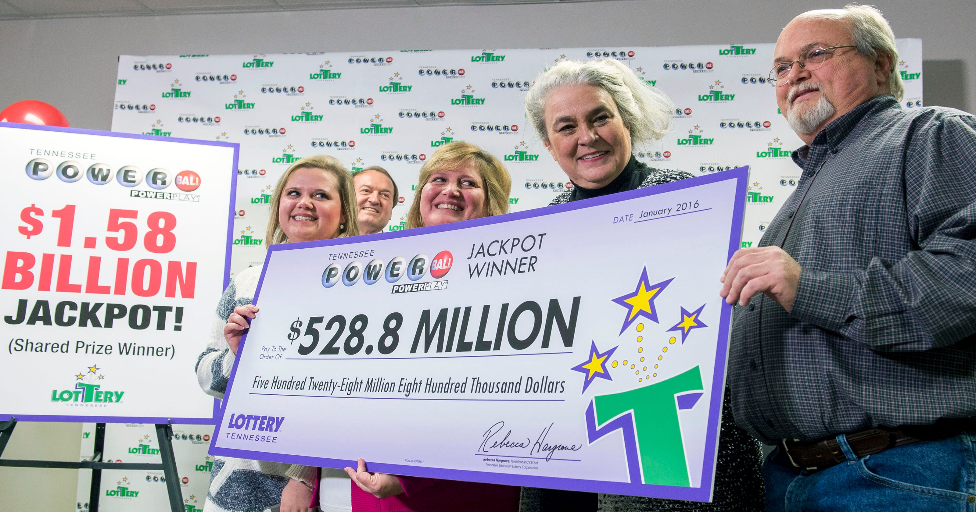 Tenn  couple picks up $528 8M Powerball check