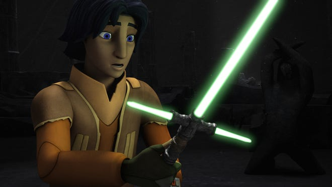 "Ezra Bridger (voiced by Taylor Gray) stumbles upon an ancient lightsaber in the season finale of ""Star Wars Rebels."""
