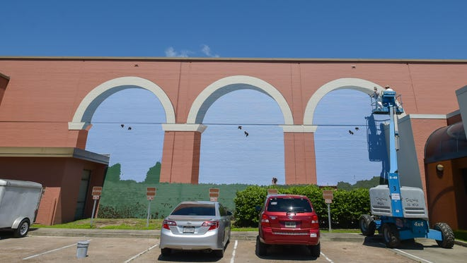 Robert Dafford painting Mural on Lafayette's City Hall Building.