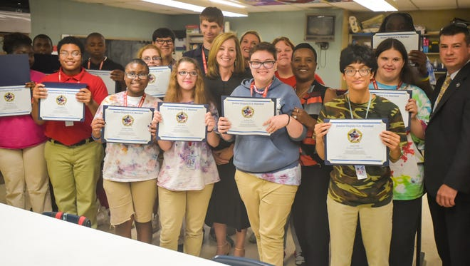 Comeaux High students honored as Juniour US Marshalls.