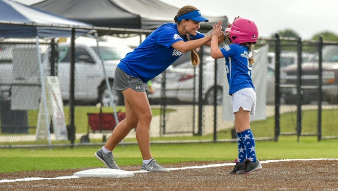 Youngsville coach Rachel Stutes celebrates with Carleigh Romero as the Youngsville Shetland All-Stars 6U competed at the PONY Softball World Series this weekend at the Youngsville Sports Complex.