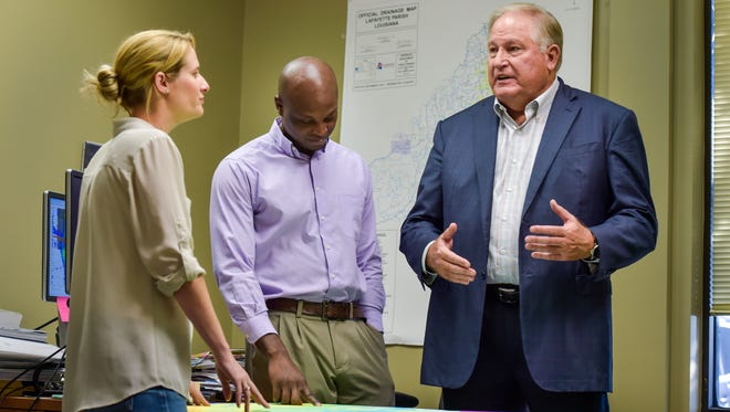 Jeanne Arceneaux-Hornsby, engineering Director at Fenstermaker and Associates (left); Robert Miller, project engineer (center); and Bill Fenstermaker, chairman and CEO, discuss what they see for Louisiana in the wake of this flooding and where the state can go from here.
