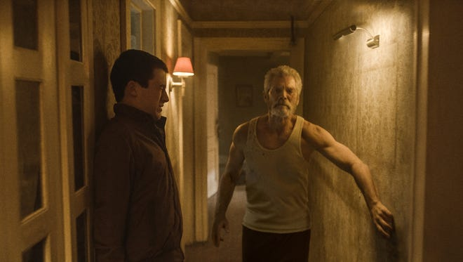 """This image released by Sony Pictures shows Dylan Minnette, left, and Stephen Lang in a scene from """"Dont Breathe."""" (Sony/Screen Gems via AP)"""