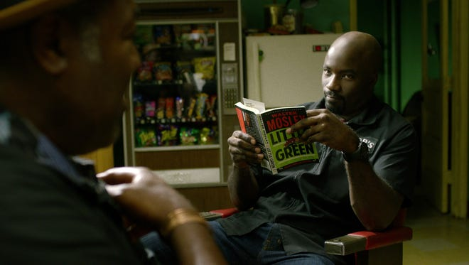 Luke (right, Mike Colter) gets some sage advice from Pop (Frankie Faison) in 'Marvel's Luke Cage.'