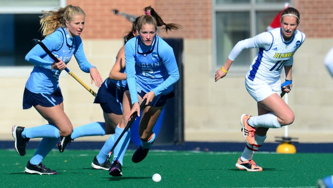 Lauren Moyer, center, scored a goal for the University of North Carolina in its 3-2 loss Sunday to the University of Delaware in the NCAA Division I women's field hockey championship game in Norfolk, Virginia.
