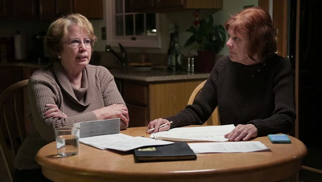 Abbie Schaub, left, and Gemma Hoskins, former students searching for the truth of Sister Cathy Cesnik's death, are featured in Netflix's 'The Keepers.'