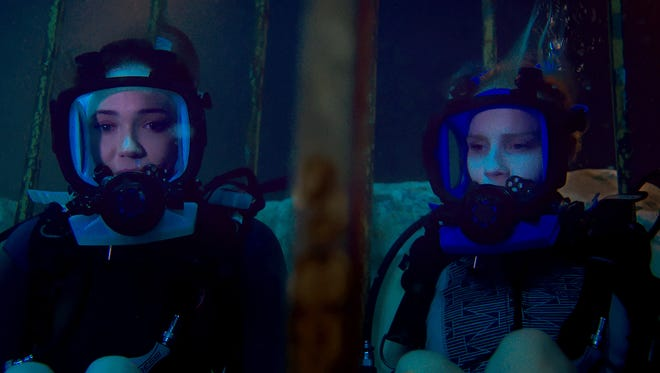 "Lisa, played by Mandy Moore, and Kate, played by Claire Holt, are stuck at the bottom of the ocean floor after their shark-diving excursion goes terribly wrong in ""47 Meters Down."""