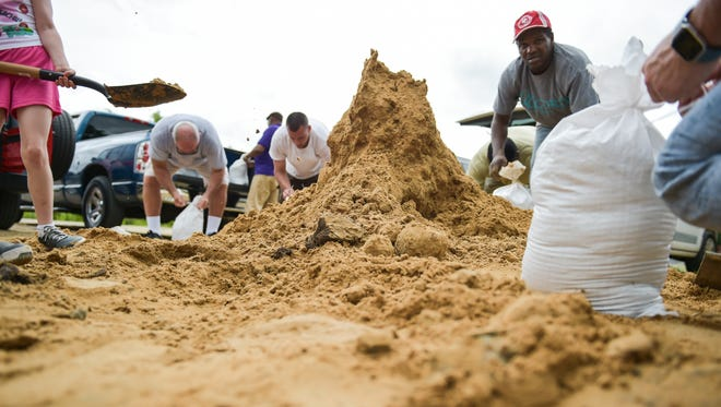 Residents fill sandbags in preparation for Tropical Storm Cindy to make landfall.- Tuesday, June 20, 2017.