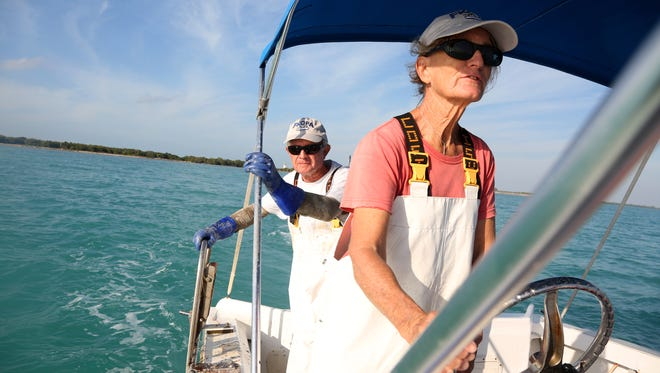 Mimi Stafford, right, and Simon Stafford, who are married and fish commercially, head out to check lobster traps off Key West, Fla., in January.