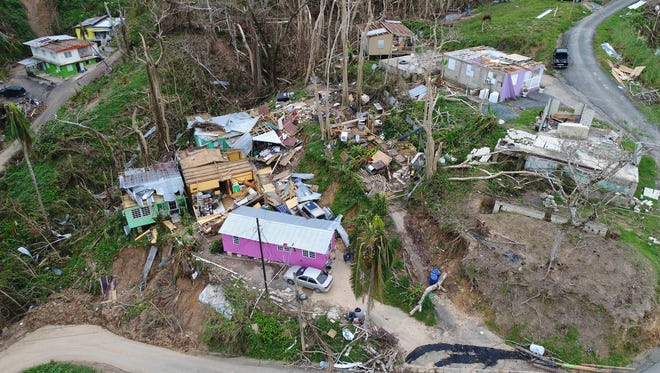 Several homes in Naranjito, Puerto Rico , seen above Sept. 30,  2017, from a drone, were destroyed in Hurricane Maria. The town, like many on the island, is without potable water and electricity.