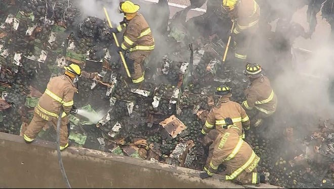 Firefighters in Forreston, Texas, battle smoke Dec. 28, 2017, after a big rig carrying 40,000 pounds -- 20 tons -- of avocados caught fire on Interstate 35E about 25 miles south of Dallas.