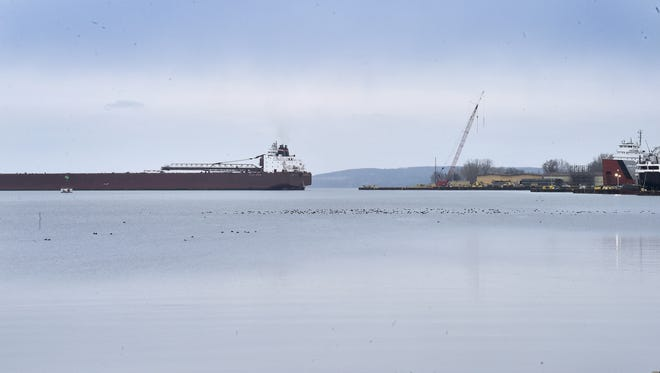 The Mesabi Miner backs into Fincantieri Bay Shipbuilding on Dec. 4, 2016. One of the largest on the Great Lakes, the 1,000-foot, self-unloading bulk carrier is the next freighter expected to dock for winter maintenance at Bay Ship tentatively scheduled for arrival on Jan. 10. The freighter sails the Great Lakes under the Interlake Steamship Co. flag in the coal and iron ore (taconite pellet) trades much as she has since her launch in 1977.  Mesabi Miner was named to honor the people of the Mesabi Iron Range who had encouraged the development of the mining industry in Minnesota.