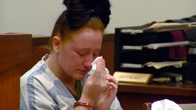 Nicole Carmon sheds a tear Jan. 4, 2018, after learning that she was sentenced to eight years in prison and three on probation.