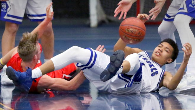 Whitefish Bay's Jayden Jackson (right) collides with Homestead's Jared Schneider at Whitefish Bay on Feb. 6.