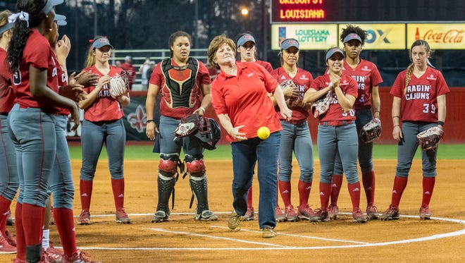 Yvette Girouard throws out the first pitch as the Louisiana Ragin' Cajuns softball take on Oregon. Thursday, Feb. 15, 2018.