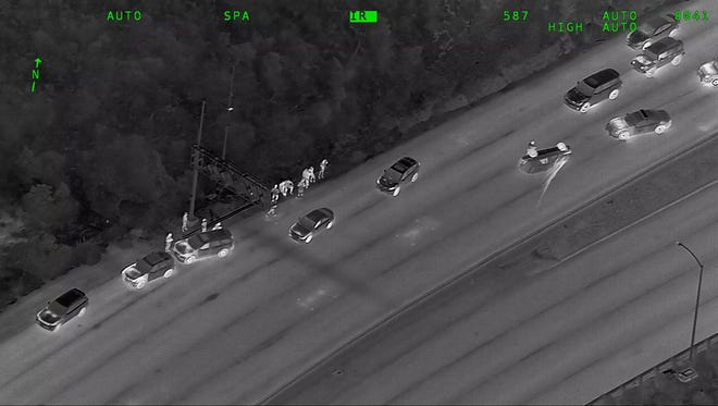 This image using forward-looking infrared technology from the California HIghway Patrol shows an overturned SUV May 26, 2018, in the southbound lanes of U.S. 101 in Sausalito, Calif.
