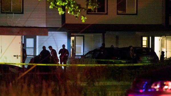 Boise police investigate at a crime scene near the