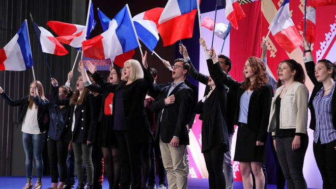 """A Le Pen-like politician (Catherine Jacob) leads singing with arms outstretched during a rally in """"This Is Our Land (Chez nous),"""" opening Friday."""