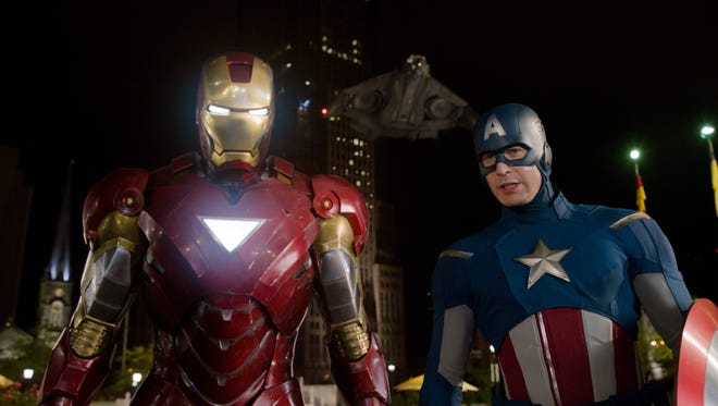 Iron Man, portrayed by Robert Downey Jr., left, and Captain America, portrayed by Chris Evans, will go up against DC superheroes at the box office.