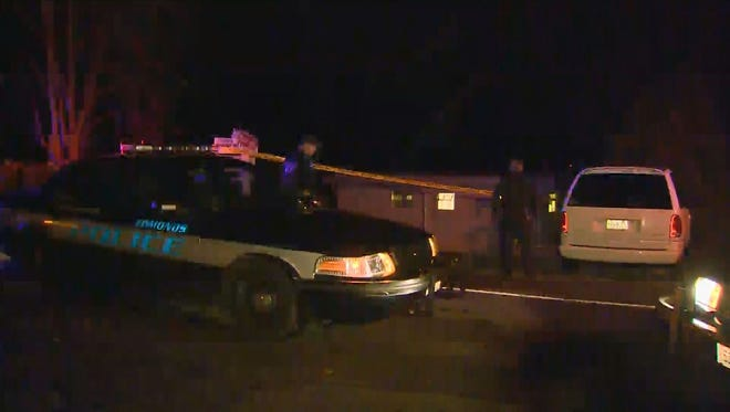 Police respond to a shooting at a rental house in Edmonds, Wash., in which a mother of three shot an intruder entering her house at 3 a.m. PT Thanksgiving Day.