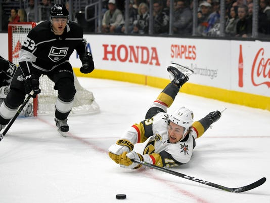 Vegas Golden Knights left wing Brendan Leipsic, right, falls as he passes the puck while under pressure from Los Angeles Kings defenseman Kevin Gravel during the first period of an NHL hockey game, Thursday, Dec. 28, 2017, in Los Angeles. (AP Photo/Mark J. Terrill)